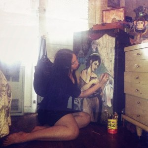 Kat painting a gorgeous steamer trunk that I absolutely adore (seriously, guys--someone buy me this). Image is hers.